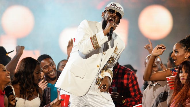 R. Kelly performs during the 2015 Soul Train Awards in Las Vegas.