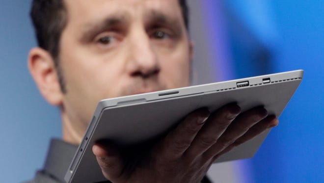 Panos Panay, Microsoft's vice president for surface computing, introduces the Surface Pro 3 tablet device at a media preview, Tuesday, May 20, 2014 in New York.