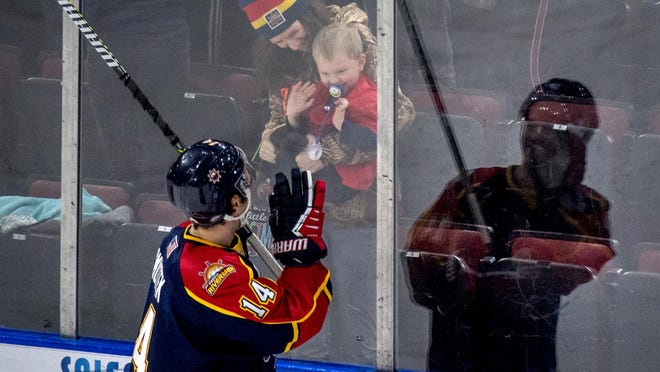 Peoria's Skyler Smutek waves to a child in the crowd after the Rivermen game last season at the Peoria Civic Center. The Rivermen are one of five SPHL teams to opt out of the 10-team league for the 2020-21 season.