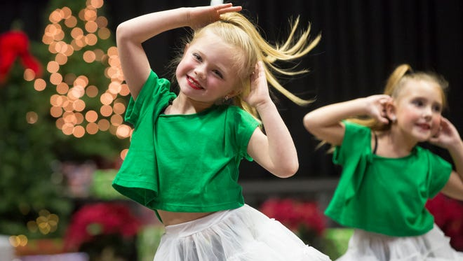 Members of the Cole Dance Academy perform a routine at the 81st annual Community Christmas Sing on Dec. 3 at Worthen Arena.