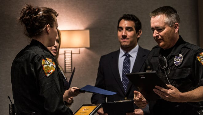 Officers Chelsi Rubio and Mark Dickman were honored at the Red Cross Heroes Breakfast Tuesday morning for their role in assisting a victim during a domestic violence call.