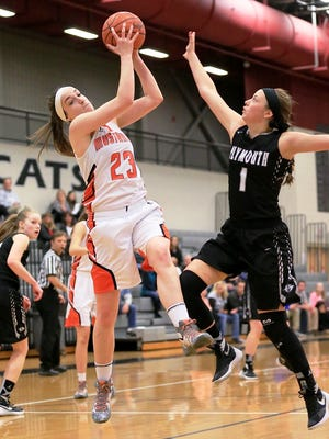 Northville's Lindsey Rathsburg (left) pulls down the rebound in front of Plymouth's Gabby Chouinard.