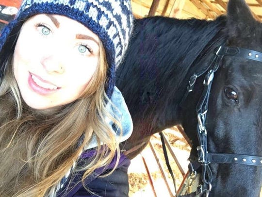 Sarah Anderson, riding her horse Fox, found the two