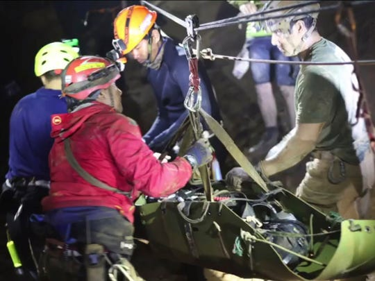 This undated photo from video released via the Thai NavySEAL Facebook Page on July 11, 2018, shows rescuers with an evacuated boy inside the Tham Luang Nang Non cave in Mae Sai, Chiang Rai province, in northern Thailand.