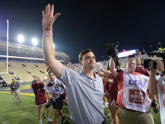 FILE - In this Sept. 30, 2017, file photo, Troy head coach Neal Brown celebrates his team's 24-21 victory over LSU in an NCAA college football game in Baton Rouge, La. Neal Brown and the Troy Trojans are hoping they're now better equipped to handle success this time around. The Trojans (8-2) have followed up their best Division I season with another run at the Sun Belt Conference championship, along with one of the biggest wins in program history. (AP Photo/Matthew Hinton)
