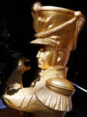 A gold toy Christmas soldier from inside one of the storage sheds.