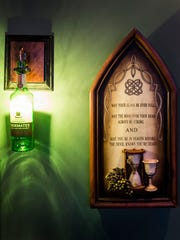 Jameson bottles act as light fixtures in the upstairs