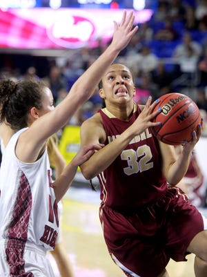 Riverdale's Brinae Alexander (32) goes  up for a shot as she is guarded by Morristown West's Blayke Shultz (10) during the State Tournament quarterfinals on Wednesday March 9, 2016, at MTSU.