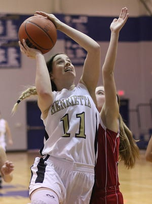Henrietta's Maddie Brown attempts a layup while guarded by a Electra defender in the Windthorst Tournament Tuesday, Dec. 27, 2016, in Windthorst.