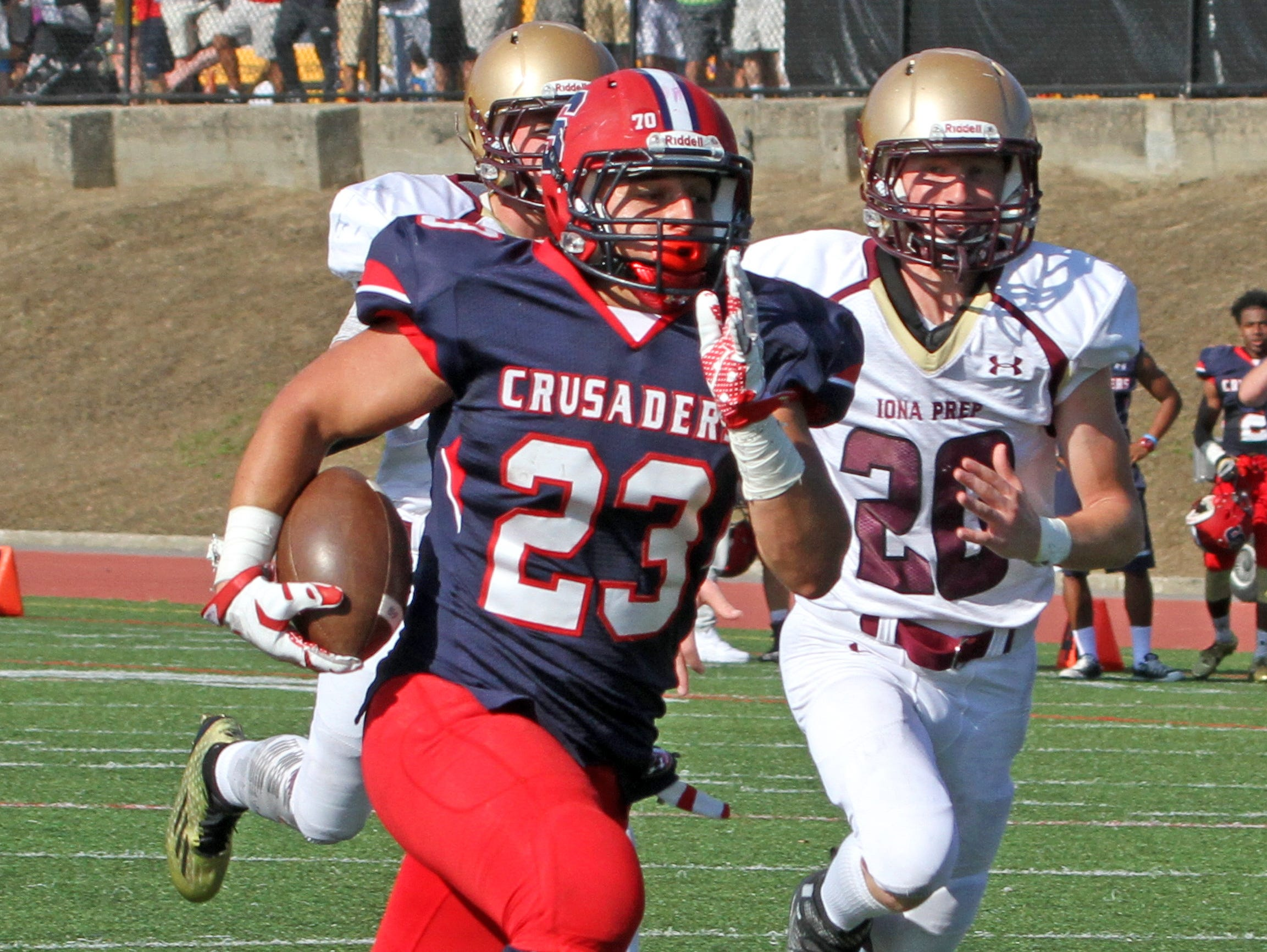 Stepinac's Antonio Giannico rushes for a 28-yard touchdown during a varsity football game at Stepinac High School Sept. 19, 2015. Stepinac crushed Iona Prep 48-6.
