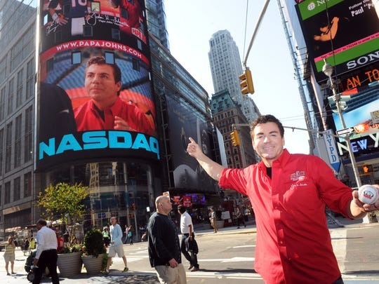 Papa John's Founder, Chairman and CEO John Schnatter gets a kick out of seeing his image on the NASDAQ tower in New York's Times Square, Friday, Sept. 14, 2012, while celebrating the opening of the brand's 4,000th global restaurant. This week, Schnatter resumed the role of president for the third time since founding the pizza chain, upon the recent departure of Tony Thompson to lead Krispy Kreme. (Photo by Diane Bondareff/Invision for Papa John's International/AP Images)
