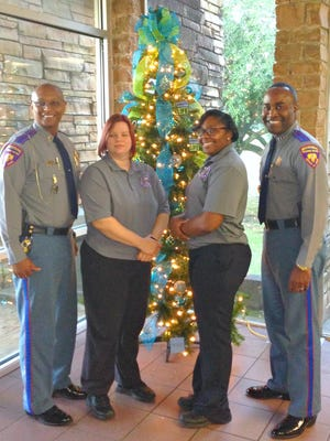 DPS staff are pictured with a Donate Life tree at DPS Headquarters in Jackson.
