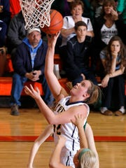 Abby Nakfoor goes in for a layup during DeWitt's victory