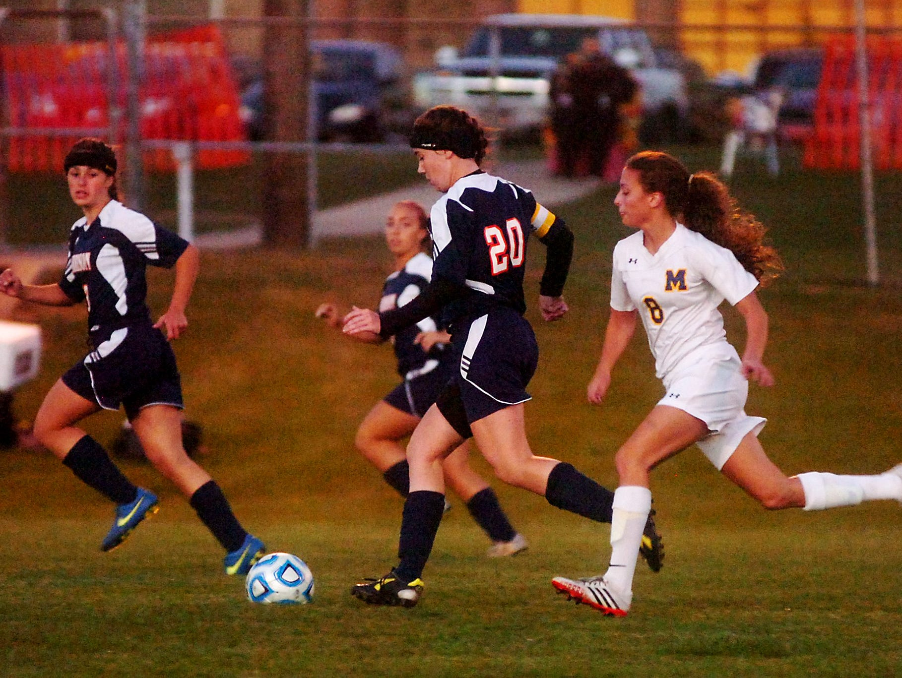 Harrison's Lauren DeCamp brings the ball upfield against Marion.