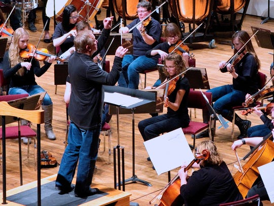 """""""Home for the Holidays,"""" the annual Youth Orchestra alumni concert, takes place Wednesday at the Mansfield Theater."""