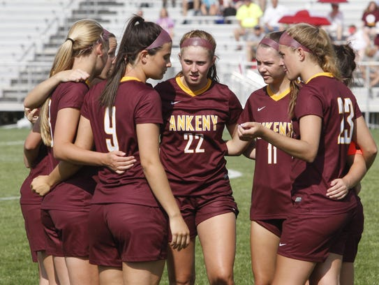 The Ankeny players huddle up before the start of their