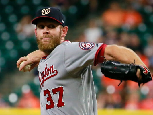 Washington Nationals' Stephen Strasburg delivers a pitch to the Houston Astros during the first inning of a baseball game Thursday, Aug. 24, 2017, in Houston. (AP Photo/Richard Carson)