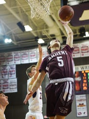 Ankeny's Reece Pitz (5) goes up for a shot during a