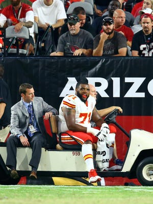 Kansas City Chiefs offensive lineman Jeff Allen is taken off the field on a medical cart with a trainer after suffering an injury against the Arizona Cardinals during a preseason game.