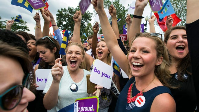 Supporters of gay marriage cheer outside the Supreme Court on Friday.