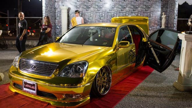 Noel Manansala's 2003 Lexus LS430 displayed at a car show.