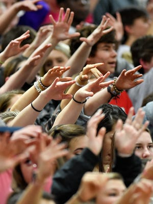 Franklin fans raise their hands during a free-throw against Brentwood during the second half at Franklin High School in Franklin, Tenn., Monday, Jan. 29, 2018.