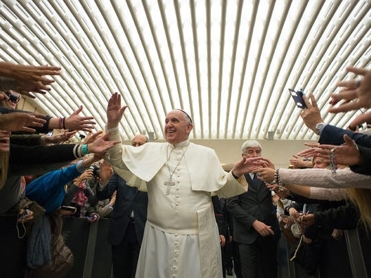 Pope Francis is cheered upon his arrival for the weekly