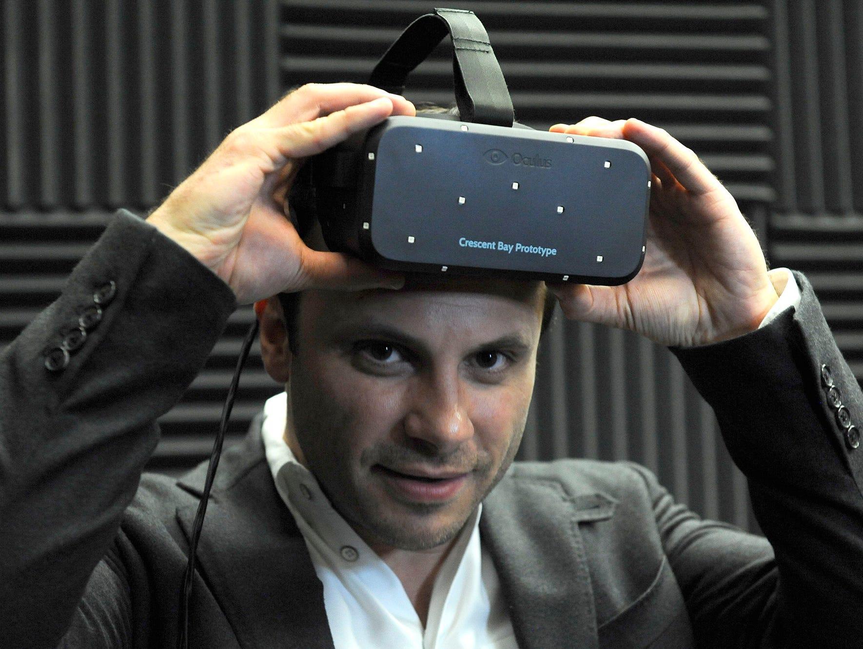Oculus VR CEO Brendan Iribe shows off Oculus Rift.