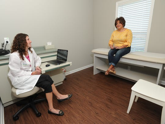 Dr. Christina Bovelsky meets with Christy Beckman of Middletown at Peachtree Famly Medicine in Middletown.  Dr. Bovelsky offers patients a monthly fee for unlimited services.