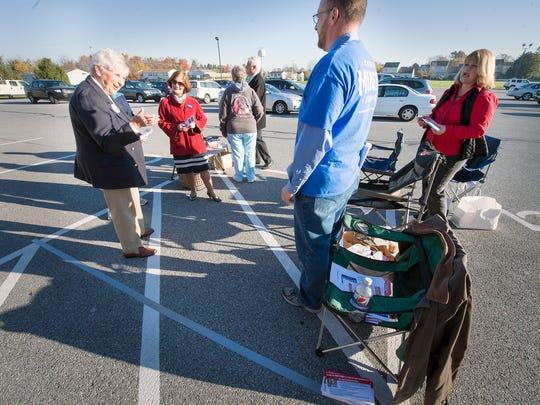 The gauntlet at the Dover Township polling place No. 1 was very tightly boxed in between two handicapped parking spaces and a taped line to keep candidates and supporters away from the door Election Day.