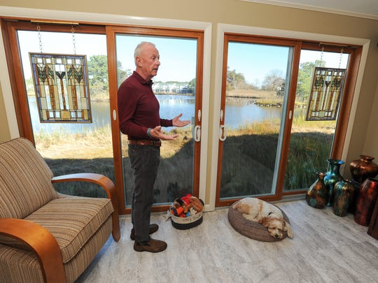 Richard Heubeck in his condo in the Mallard Lakes development in Selbyville.  Heubeck is one of several plaintiffs in a lawsuit seeking to compel the Mallard Lakes condo association to spread the cost of raising four condo buildings across all 477 unit owners, not just the 24 owners of the affected buildings.