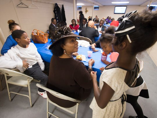 Yvette Jones, center, director of dance ministry, talks with dancers, Samaury Handy, age 8, second from right and Assata Jones, age 8, right, during a lunch before the Missionary Annual Day (2015) sponsored by the Marie Generette Women's Missionary Society at Bethel A.M.E. Church in York Sunday November 8, 2015. Kevin Way Jr.  is at left.