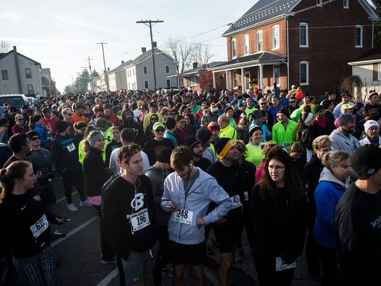 Runners crowd Berlin Avenue at the starting line on Nov. 26, 2015 for the 24th annual Thanksgiving Day Community 5k Turkey Trot in New Oxford.