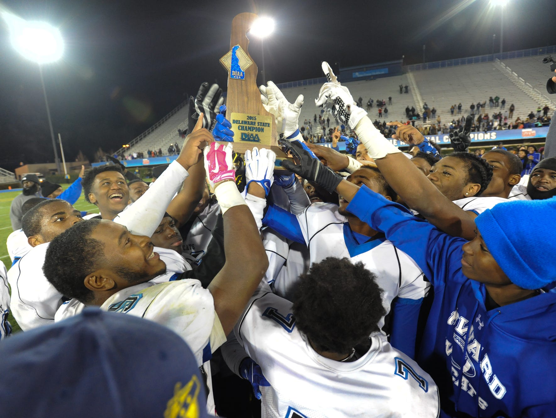 Howard players celebrate their 28-13 win over St. Georges in the DIAA Division II championship game Saturday night at Delaware Stadium.