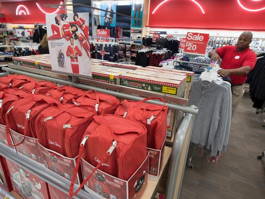 Jeremy Thomas, who normally works in human resources regionally for Target helps out on different places during the holidays at Target in West Manchester Township. The store helps spur sales with gift packs located in the men's department.