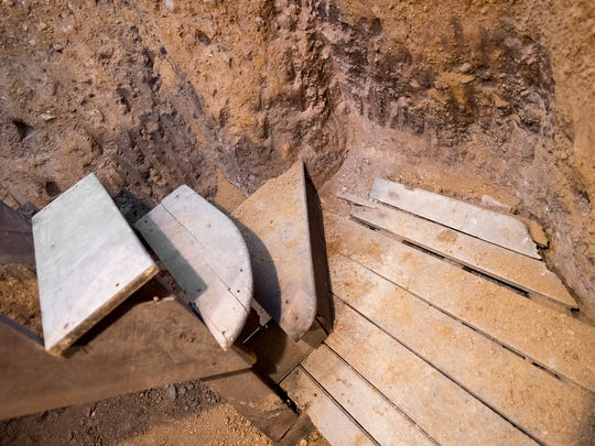 Stairs lead to a hand dug earthen basement where freedom seekers were hidden in the 1800s.