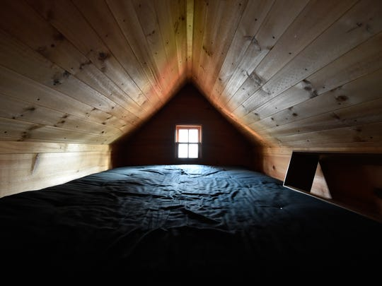 View of the sleeping area in the tiny home that Dragonfly Leathrum of Newark recently purchased.