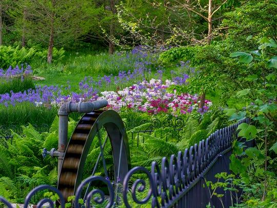 CAPTION: Unfurling fern fronds inspired Przemek Walczak and Joe Henderson to forge a coiling motif in the Waterwheel fence.