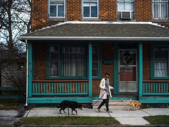 PJ Knoll walks her dogs on Baltimore Street in Hanover