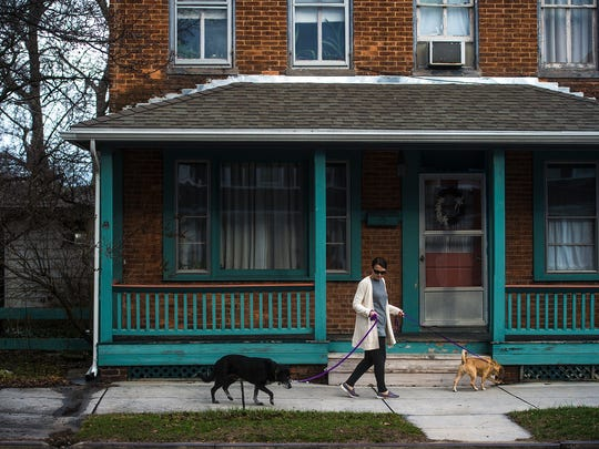 PJ Knoll walks her dogs on Baltimore Street in Hanover on Jan. 10, 2016. Knoll, 56, said she's thought about retirement and was not surprised to hear about Hanover's ranking in the survey, citing the number of retirement communities in the area and the relative ease of getting around town as attractive draws for the community.