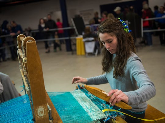 Weaver Ashley Shaw of Dauphin County's Just a Little Twisted team works on Jan. 13, 2016 at the 37th annual Sheep to Shawl competition at the Pennsylvania Farm Show.