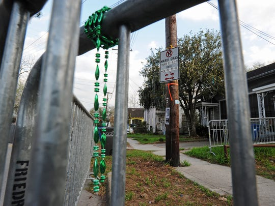 Broken Mardi Gras beads, from a parade gone by, hang
