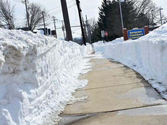 This is not the case for many borough streets, but the sidewalks in front Ben Chambers Elementary School are shoveled Monday,  Jan. 25, 2016.
