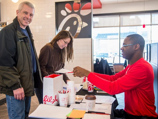 David Fleagle, left, and Laura Fleagle, center, register inside Chick-A-Fillet with Irvine Minor, Hospitality Manager, so they can win 52 free meals for the year on Wednesday, Jan. 27, 2016 in Chambersburg, Pa. At 6 a.m. 100 guest who registered and waited outside Chick-A-Fillet will recieve 52 free meal for the rest of the year.