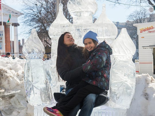 Amanda Chua and Payton Chua sit on the Russian thrown at IceFest on Saturday, Jan. 30, 2015 in Chambersburg, Pa.