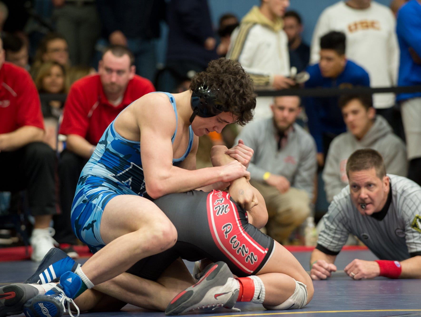 Middletown's Dante Immediate, left wrestles William Penn's Thien Nguyen in the 126 pound quarterfinals at the DIAA Individual State Tournament at Cape Henlopen High School.