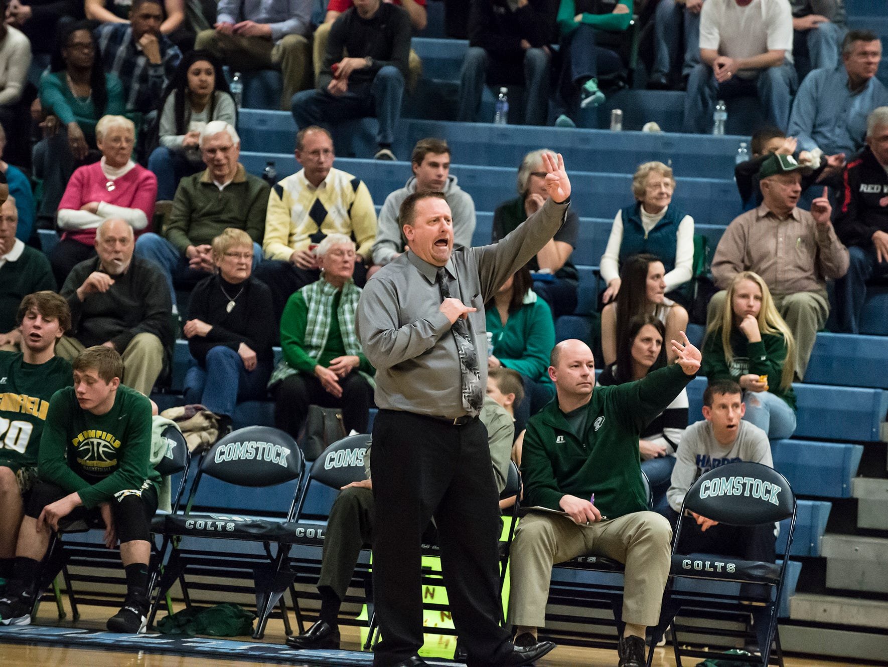 Pennfield's coach Steve Grimes reacts during Monday's district game.