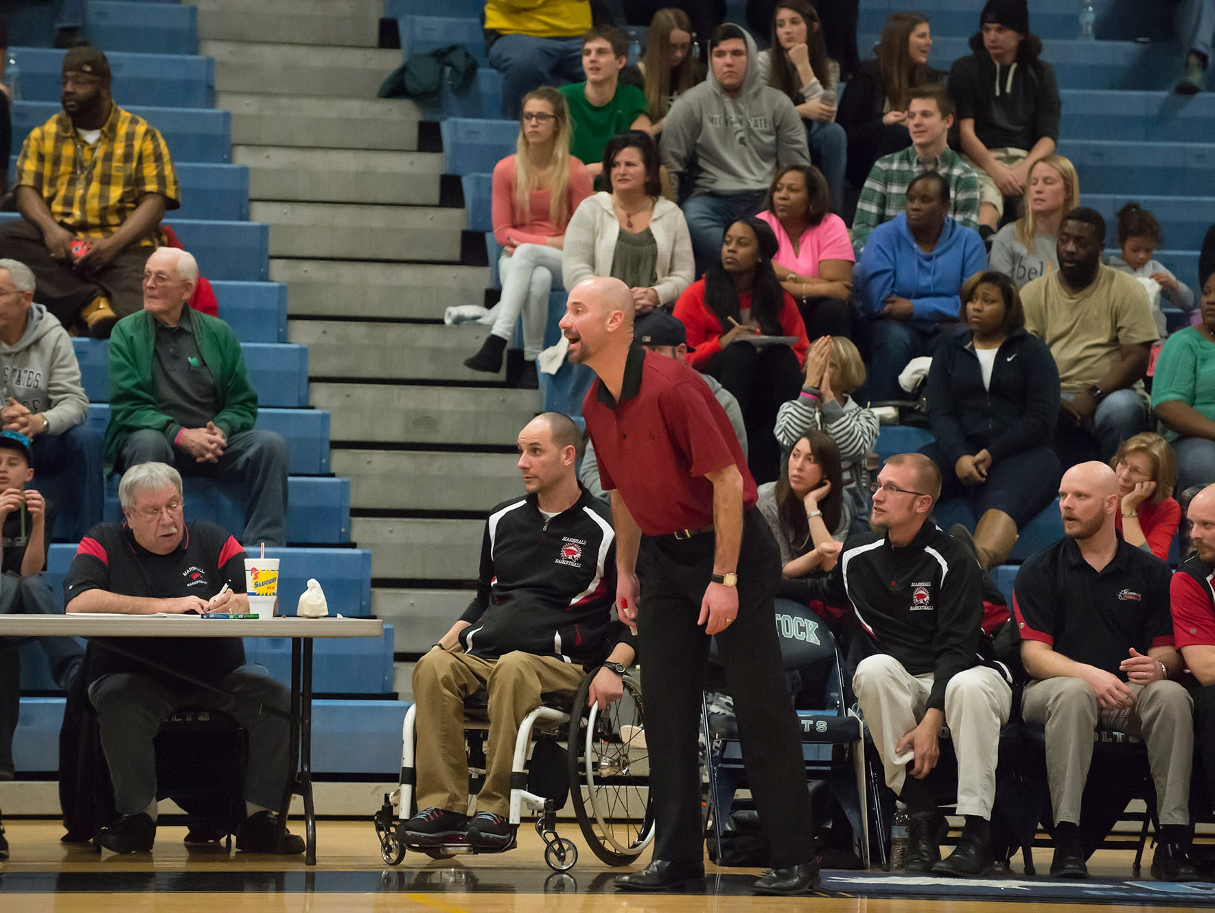 Marshall's coach Nicholas Dent reacts during Monday's district game.