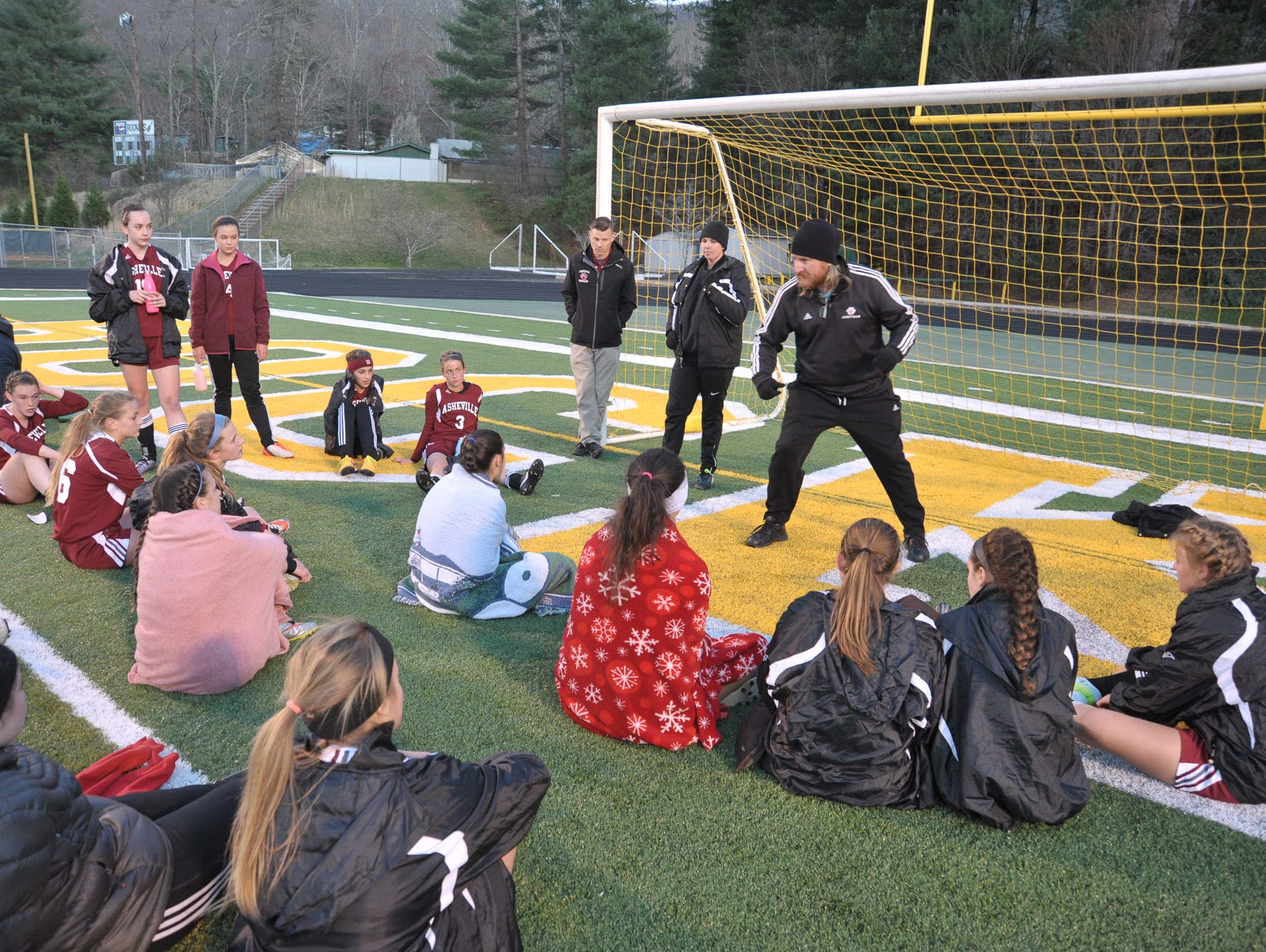 Asheville High soccer coach Mike Flowe talks to his team during a game last week at Reynolds.