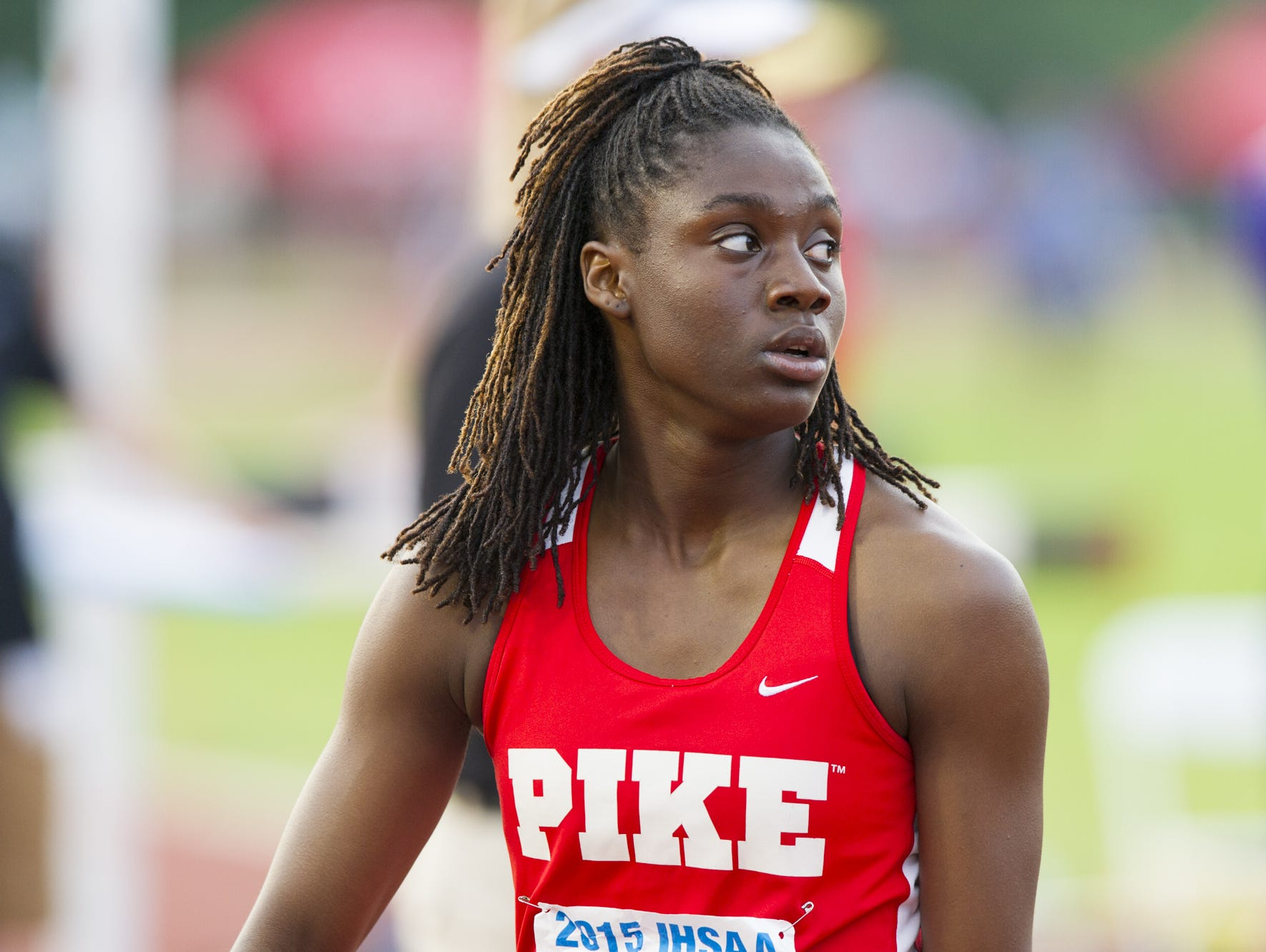 Pike High School sophomore Lynna Irby (647) looks at her time on the scoreboard after winning the 200 Meter Dash at the 42nd annual Indiana High School Athletic Association's girls track and field state finals June 6, 2015, at the Robert C. Haugh Track and Field Complex on the Indiana University campus in Bloomington.